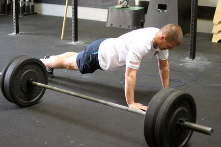 Photo of studly man doing push-ups from SnoridgeCrossfit ~ Note: MY